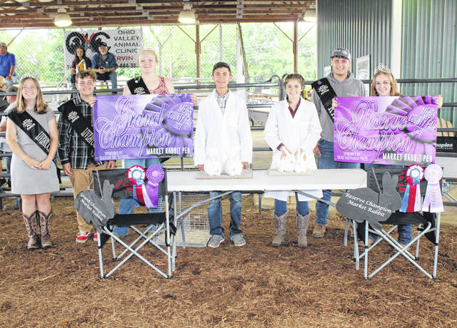 Brycen Rowe's pen of rabbits was named Grand Champion Market Rabbit, with Rachel Jackson's pen of rabbits named Reserve Champion Market Rabbit. Also pictured are Meigs County Fair Royalty Livestock Princess Lizzie Parry, Livestock Prince Jacob Fitch, Queen Olivia Harris, King Jacob Spencer, and Queen First Runner Up Shelbe Cochran.