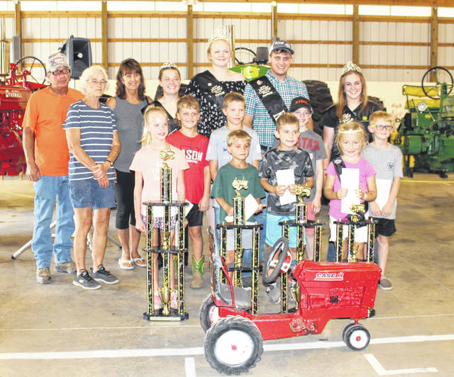 Kiddie Tractor Pull of Champions winners were (front row, from left) 35-54 pound class Brileight Marcinko, Layne Hupp, Blake Smith, Ariana Bland, (second row, from left) 55-75 pound class Colten Grubb, Weston Smith, Sawyer Bradford, Treyson Mullen, (back row, from left) sponsors Ed and Sharon Hupp and Sherry Wagner, Fair Royalty Livestock Princess Lizzie Parry, Queen Olivia Harris, King Jacob Spencer and Queen First Runner Up Shelbe Cochran.