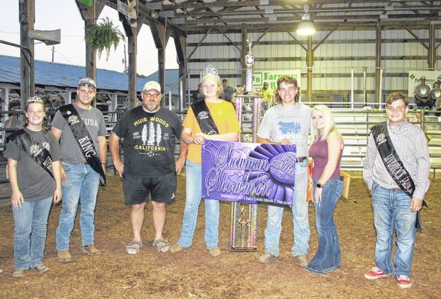 Showman of Showman winner Lucas Finlaw (fifth from left) is pictured with 2020 winner Jessica Parker (sixth from left), Meigs County Fair Royalty Livestock Princess Lizzie Parry, King Jacob Spencer, Queen Olivia Harris and Livestock Prince Jacob Fitch, and OVB Bend Area Branch Manager Dan Short, representing the event sponsor Ohio Valley Bank.
