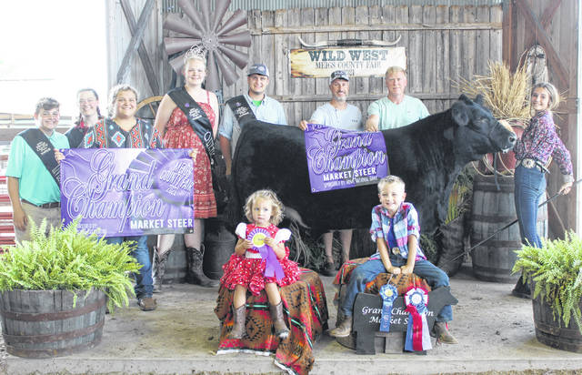 McKayla Nelson's Grand Champion Beef Steer was purchased for $5,600 by White-Schwarzel Funeral Home and Hupp Auto Center.
