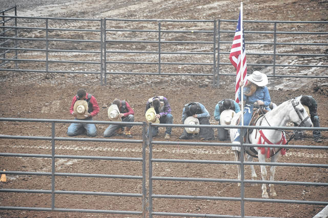 Bull riders are pictured here for prayer before the rodeo began.