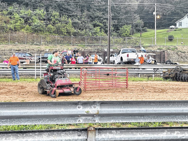 A zero-turn mower competition was held on Wednesday night at the fair.