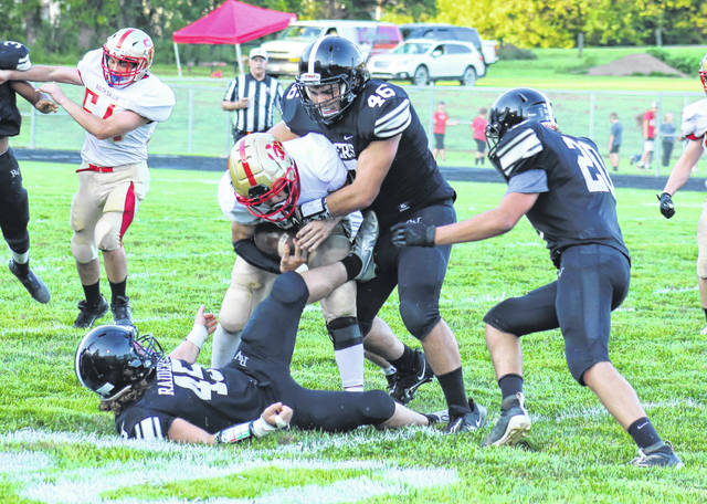 River Valley defensive lineman Elijah Perry (46) wraps up South Gallia quarterback Noah Cremeens for a tackle during the first half of Saturday night's Week 2 football contest in Bidwell, Ohio.