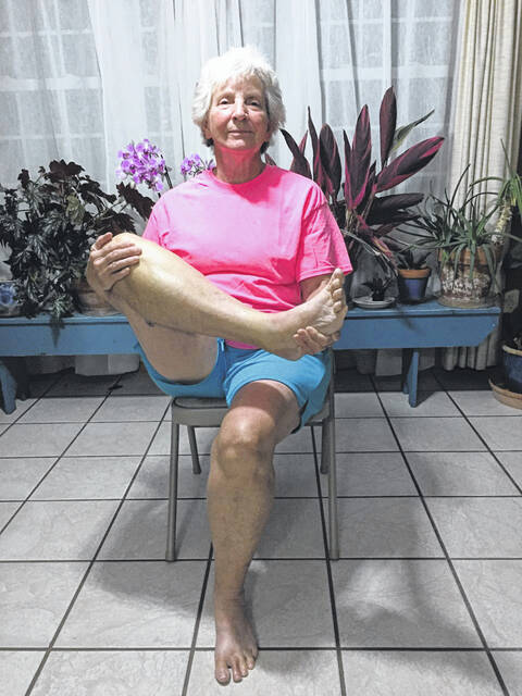 Joy Bentley, chair yoga instructor, is pictured.