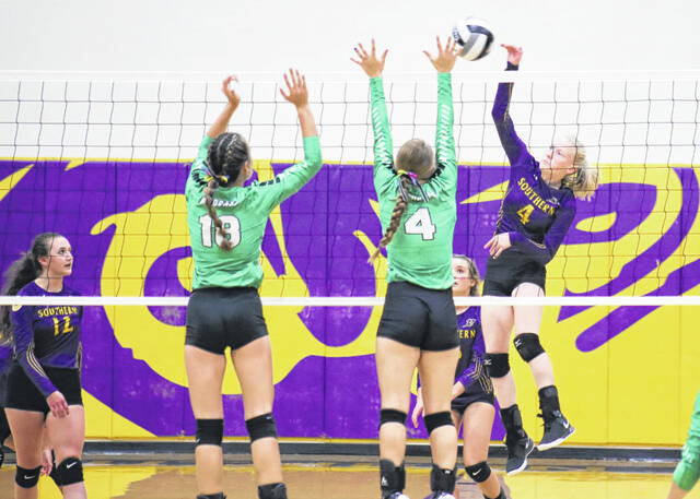 Southern senior Kayla Evans (4) hits a spike attempt during Tuesday night's TVC Hocking volleyball match against Waterford in Racine, Ohio.