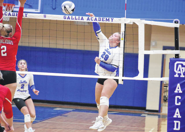 Gallia Academy junior Chanee Cremeens leaps to spike the ball against the Jackson Ironladies in a volleyball game Monday evening in Centenary, Ohio.