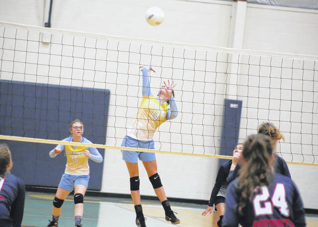 Ohio Valley Christian player Madison Beaver (14) leaps to spike the ball against Cavalry in a volleyball game Tuesday evening in Gallipolis, Ohio.