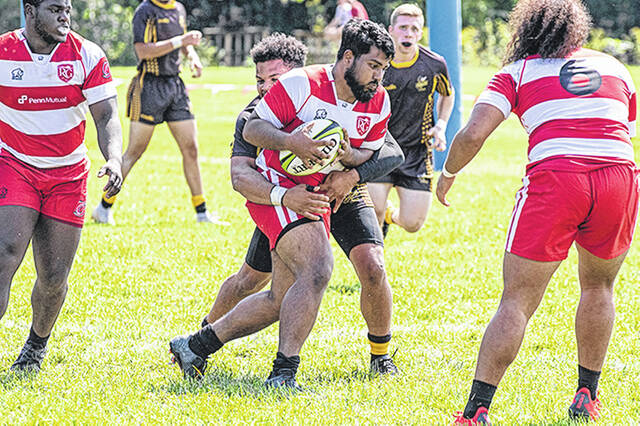 Rio Grande's Solomone Ahoia tries to break away from a Baldwin-Wallace defender during the first half of Saturday's 91-0 win by the RedStorm at the Red Valley Pitch. The contest was the first for the RedStorm's first-year program.