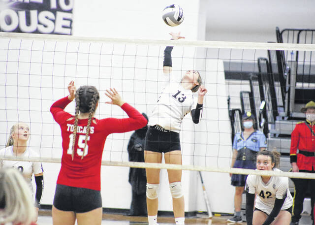River Valley senior Javan Gardner leaps to spike the ball against the Trimble Tomcats during a volleyball game Wednesday evening in Bidwell, Ohio.