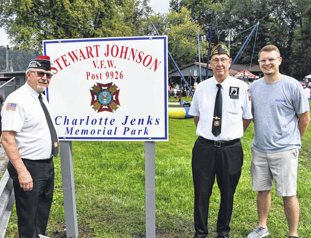 """The Mason park was rededicated prior to the start of the Mason Harvest Festival on Saturday. A new sign, declaring the park the """"Stewart-Johnson V.F.W./Charlotte Jenks Memorial Park"""" was unveiled during a ceremony. Pictured, from left, are V.F.W. Vice Commander Ray Varian, Commander Ronie Wheeler, and Mason Mayor Kristopher Clark."""