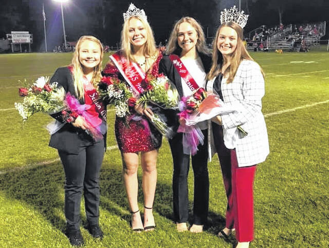 The 2021 Wahama Homecoming Queen and her court are pictured during the football game Friday evening. Pictured, from left, are Queen Candidate Bailee Bumgarner, Queen Michaela Hieronymus, Queen Candidate Jessica Dangerfield, and the 2020 Queen Mary Roush.