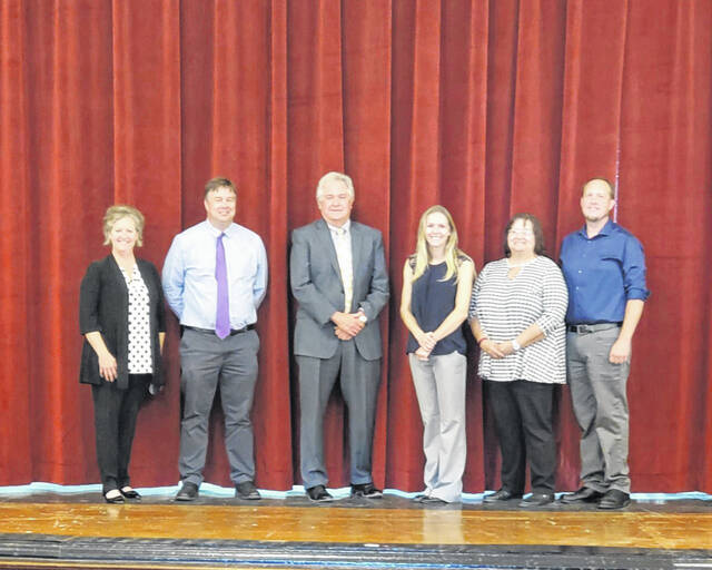 Pictured from left, representing Farmers Bank, are Lori miller, Shawn Arnott, Paul Reed; representing The Blakeslee Center are Laura Cleland, Beth Shaver, John Matson.
