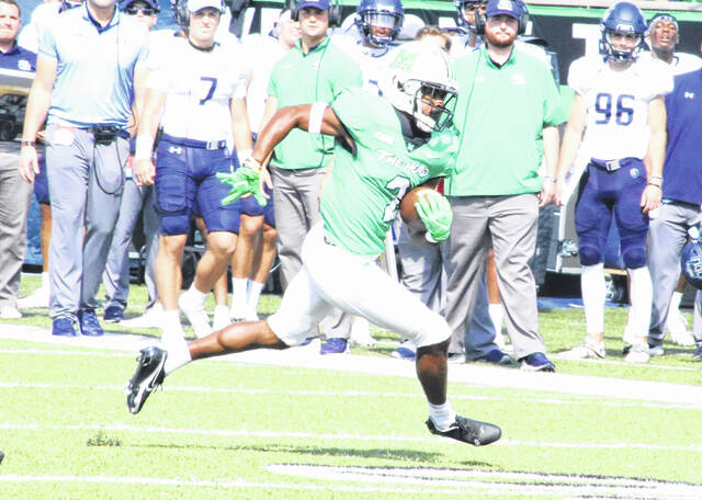 Marshall safety Cory McCoy runs toward the endzone after making an interception during a football game against Old Dominion Saturday in Huntington, W. Va.