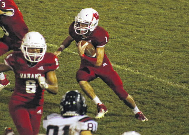 Wahama junior Aaron Henry (1) finds a hole in the Red Devil defense during a football game Friday evening in Mason, W. Va.