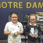 Notre Dame Elementary students helping others