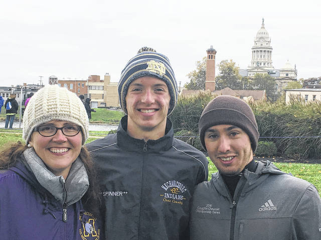 Mechanicsburg High School's Josh Spinner represented the Indians at the OHSAA Regional Cross Country finals in Troy. Spinner, pictured with coaches Elizabeth Porter and Joe Montoya, placed 33rd among the top 110 runners in the region. Josh is a freshman at Mechanicsburg and has a goal of running for a Division I university following high school.
