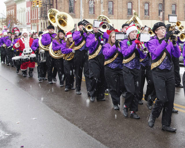 The Mechanicsburg Marching Band brought musical warmth to the otherwise chilly winter day in Mechanicsburg on Saturday. Snow arrived just in time to frost the event in Christmas spirit.
