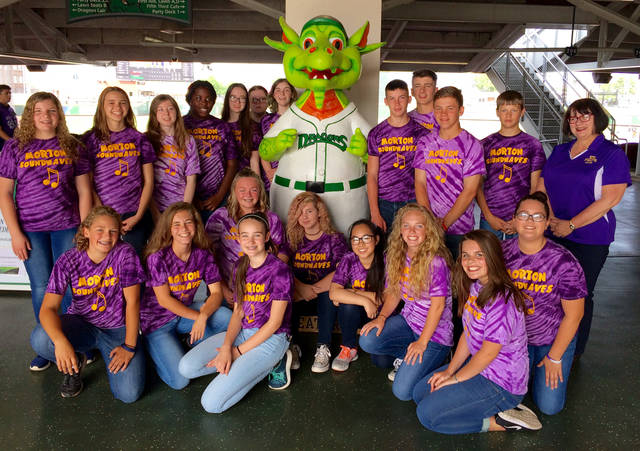 The Morton SoundwAVES performed the National Anthem at Thursday's Dayton Dragons game. They are pictured with Dragons mascot Gem.