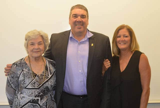 Retiring Vandalia-Butler City Schools Superintendent Bradley Neavin is pictured with his mother Stella Davidson (left) and wife Mary following Neavin's final Board of Education meeting on Tuesday.