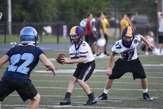 Matt Motter takes a snap when the Aviators hosted Kenton Ridge in the final 7 v 7 scrimmage of the preseason. The Aviators will begin practice on July 21 and open the season on August 25 when they host Masillon Perry.