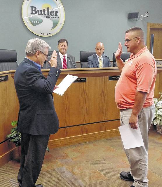 Butler Township Fiscal Officer Mark Adams (left) administers the Oath of Office to Board of Zoning Appeals Member Mike Thein.