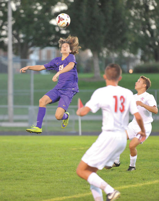 Drew Sacks goes up for a header versus Troy at Troy's Memorial Stadium.
