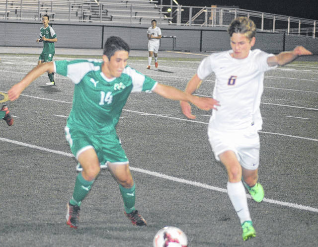 <strong>Zane Burgmeier tries to move ball past Northmont defender Justin Menker.</strong>