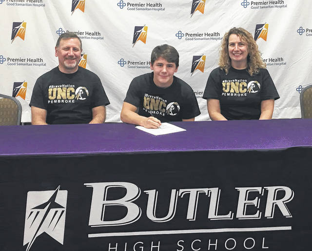 Ronnie Pietro, center, who placed seventh at the state wrestling meet a year ago, signed a National Letter of Intent with NCAA Division II UNC-Pembroke. He is pictured with his parents Joe and Meg Pietro.
