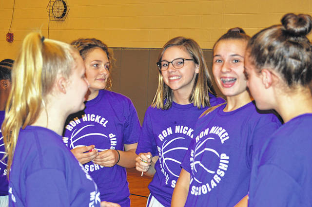 Members of the Morton Middle School eighth grade girls basketball team wore t-shirts honoring former coach Ron Nickel on Thursday.