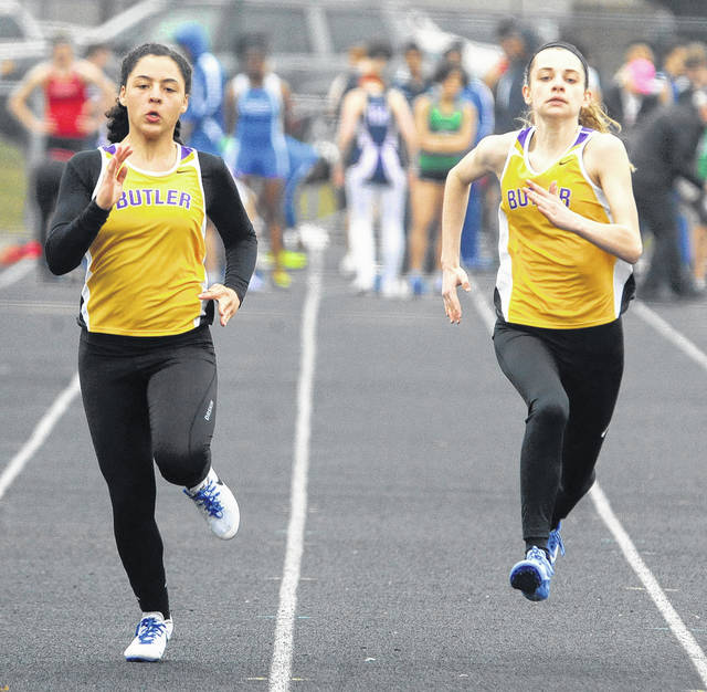Butler's K-La Spieles and Mikayla Molesky run the girls 100 meter dash event at Wednesday's Troy Invitational Track meet