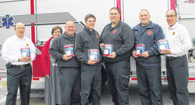 Members of the Butler Township Fire Department received a donation of carbon monoxide detectors from the Dayton Firefighters Federal Credit Union.