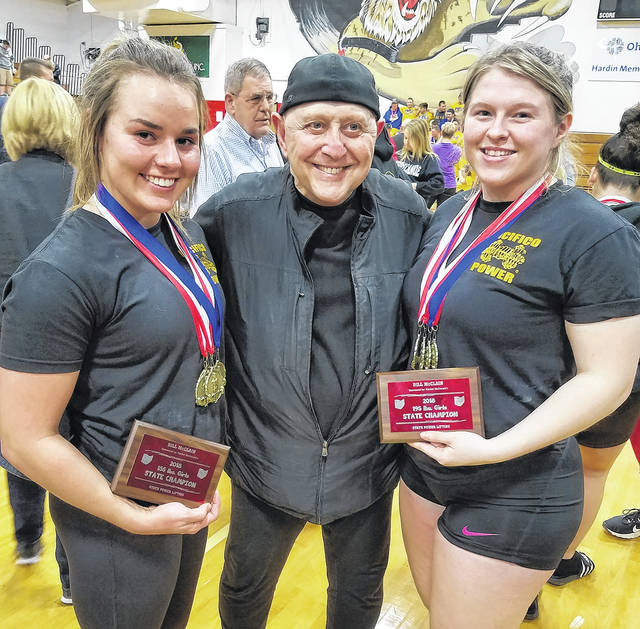 Butler students Kelsi Hoops (left) and Hayden Edgell (right) set a world record for competitors under age in the Double Deadlift at the Arnold Classic in Columbus on March 4 by lifting 700 pounds. They also won the Ohio high school state championship on March 10. They are pictured with coach Larry Pacifico.