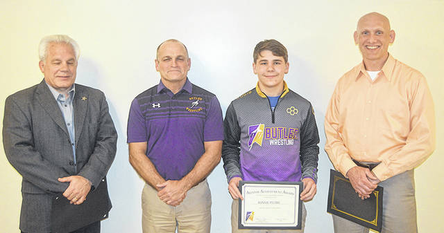 Butler wrestler Ronnie Pietro, third from left, was honored for placing fourth at the OHSAA State Wrestling Tournament and also for being a four-time State placer. He is pictured with coaches, left to right, Phil Plummer, Mark Peck, and Kelly Stevens.