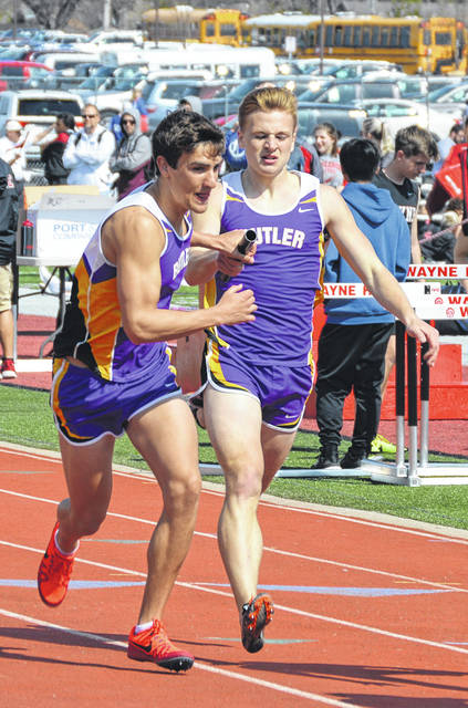 Adam Gunkel hands the baton off to Ryan Wertz during the distance medley relay at the Wayne Invitational.