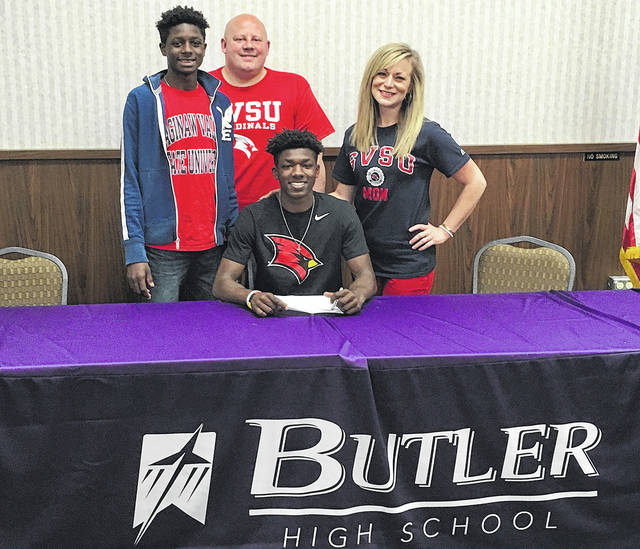 Butler track standout Daiton Sharp recently signed a National Letter of Intent to run track and field at Saginaw Valley State University in Michigan. He is pictured with his parents Erica and Adam Sharp.