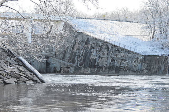 High water from heavy rains last week were still flowing through the Taylorsville Dam on Monday morning as a light coating of snow fell overnight Easter Sunday into Monday morning. The snow was the third measurable snow since the official beginning of Spring on March 21.
