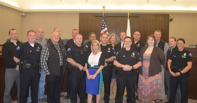 Vandalia Police Chief Kurt Althouse is pictured with members of the Vandalia Police Department moments after he was sworn in.