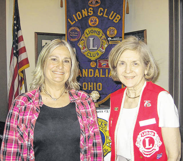 Tama Cassidy )left) of the Dayton Underground Grotto Society is pictured with with Vandalia Lions Club Program Chairperson Dee Smith (right).