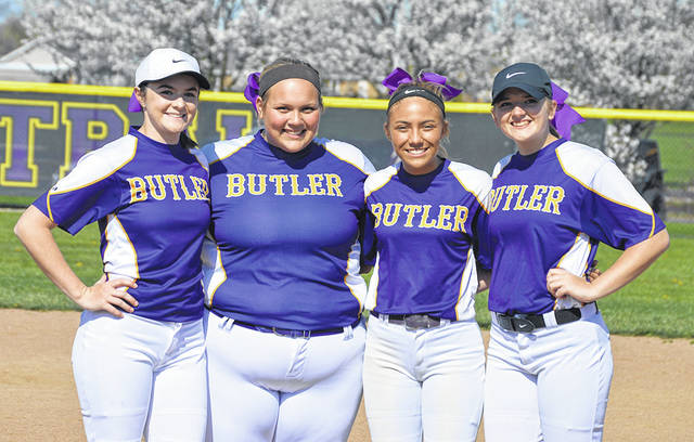 The Butler softball team honored seniors (left to right) Katie Henry, Katy Clark, Lyndsay Achs, and Becca Helke prior to outlasting the Xenia Lady Buccs 11-10 on Friday.