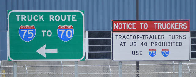Signs have been erected to notify semi-truck drivers that right hand turns are no longer permitted from Dixie Drive onto National Road in an effort to decrease truck traffic on National Road between I-75 and Dog Leg Road.