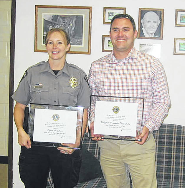 Butler Township's first responders honored by the Lions Club are, right left, Officer Amy Carr and Todd Flohre. Not pictured is Reed Rohr.