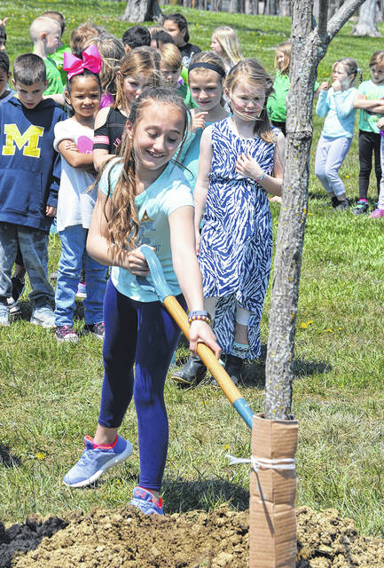 Students from Helke Elementary School helped plant an Espresso Kentucky Coffeetree as part of the City of Vandalia's Arbor Day celebration.