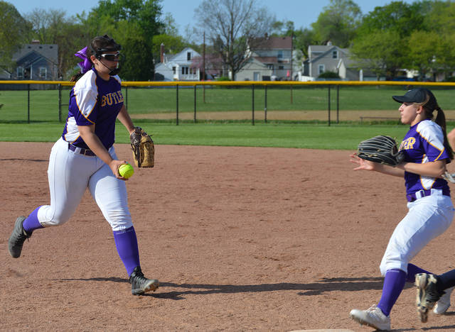 Megan Allen (left) and Amber White attempt to get an out on a short grounder during Butler's 11-10 win over Fairmont.