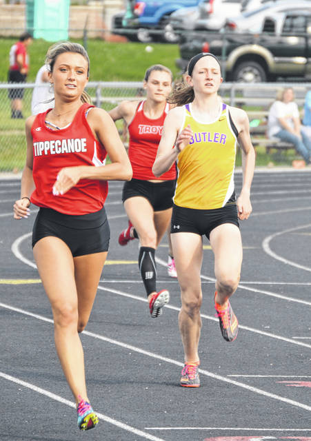 Abbie Schoenherr runs in the 400 meter dash during the Greater Western Ohio Conference championships at Troy High School.