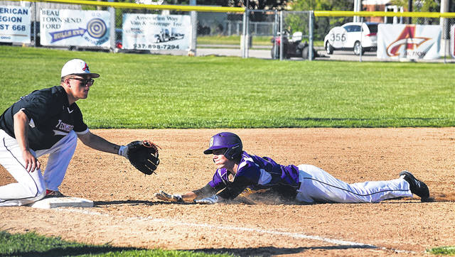 Cam Miller slides into third base during Butler's 11-1 win over Tecumseh on Thursday.