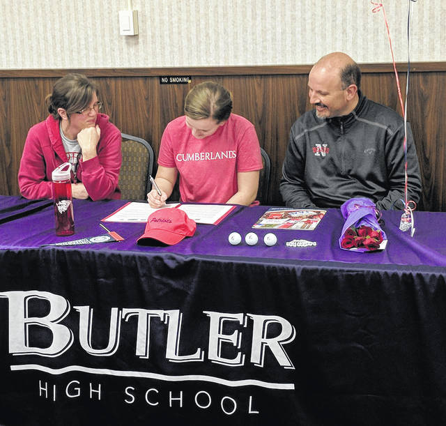 Butler senior Kaitlyn Jackson signed a scholarship to play golf at the University of the Cumberlands last week. She is pictured with her parents Tammy and David Jackson.