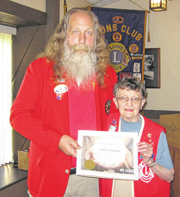 Lions Club District Governor John Bond acknowledged Lion Stella Williams' distinguished achievement toward the Lions Club International Foundation mission.