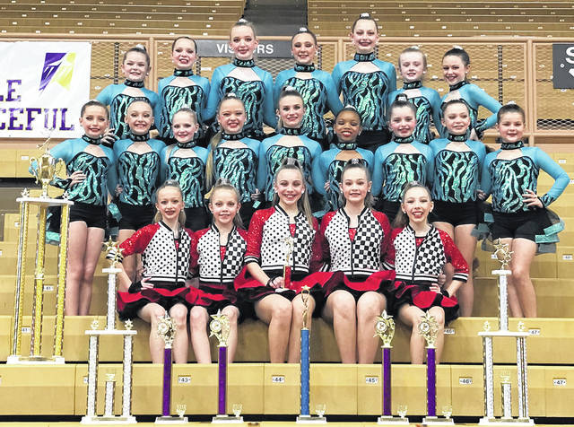 The Mini Expressions dance team is row one, left to right, Officer Zoey Grimes, Officer Taylor Harris, Captain Kiersten McBride, Co-Captain Annabel Lozan, Co-Captain Breanna Christy, Officer Mayci Minnich; second row Keira Wagner, Becca Atkinson, Grace Weber, Emma Cox, Olivia Kreusch, Davonna Harris, Emery McConnaughey, Alyssa Stratman, Lily Bihl; third row Reagan Downey, Ava Williamson, Ella Shuchat, Sophia Updyke, Ally Sowers, Makayla Brush, and Ava Schrimpf. Not pictured is Stella Czarnecki.