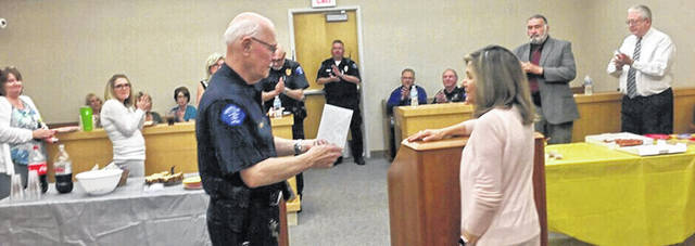 Vandalia Municipal Court Judge Cynthia Heck (right) makes a presentation to Chief Bailiff Carl Curry during a retirement reception in his honor.