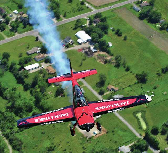 Mike Ullery | Daily Call John Klatt of John Klatt Air Shows flies over the Dayton countryside in his Jack Links Extra 300 on Wednesday as he prepares to thill crowds at this weekend's Vectren Dayton Air Show.